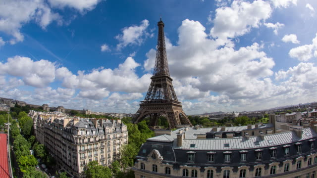 eiffel tower, elevated aerial view over rooftops, paris, france, europe - time lapse - eiffel tower paris stock videos & royalty-free footage