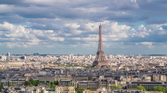 eiffel tower, elevated aerial view over rooftops, paris, france, europe - time lapse - eiffelturm stock-videos und b-roll-filmmaterial
