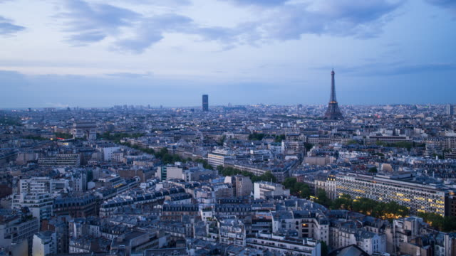 vidéos et rushes de eiffel tower, elevated aerial view over rooftops, paris, france, europe - night to day time lapse - ornement