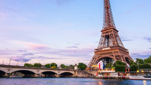 eiffel tower from across seine river time lapse - eiffel tower stock videos and b-roll footage