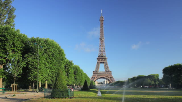 ws eiffel tower from champ de mars at early morning, paris, france - eiffel tower stock videos and b-roll footage