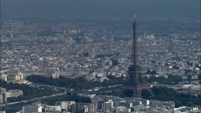 eiffel tower in sun  - aerial view - île-de-france, paris, france - wide stock videos & royalty-free footage