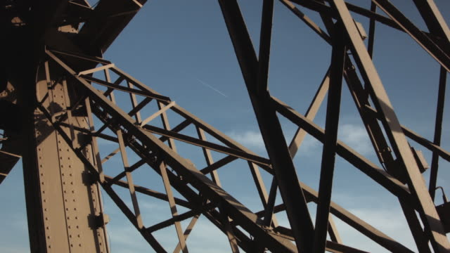eiffel tower iron lattice (with airplane passing) - aufnahme von unten stock-videos und b-roll-filmmaterial