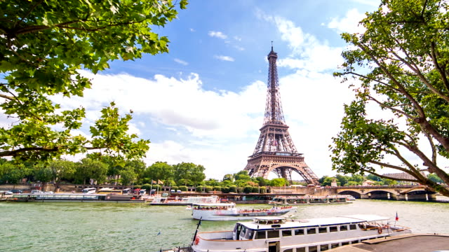 eiffel tower over seine - eiffel tower stock videos & royalty-free footage