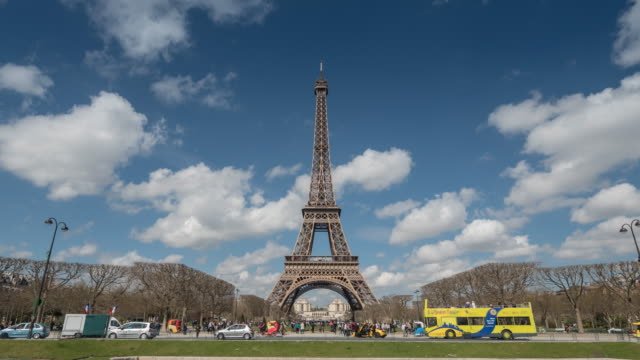 eiffel tower with tourist in summer, paris, beautiful sky, tilt down - eiffel tower stock videos and b-roll footage