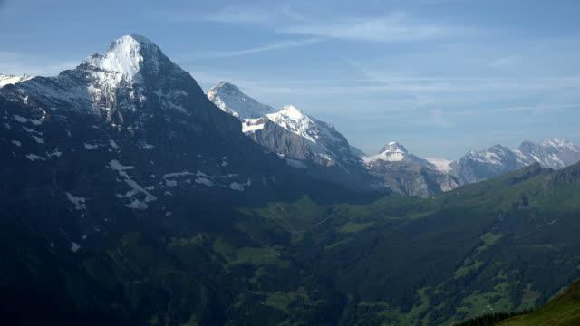 eiger and jungfrau seen from first, grindelwald, bernese alps, switzerland, europe - berner alpen stock-videos und b-roll-filmmaterial