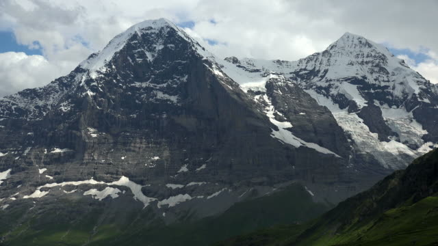 eiger and moench, bernese alps, canton of bern, switzerland - bernese alps stock videos & royalty-free footage