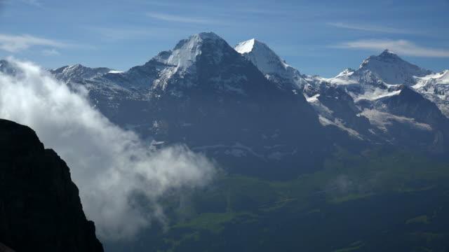 eiger, mönch and jungfrau, grindelwald, bernese alps, switzerland - bernese alps stock videos & royalty-free footage