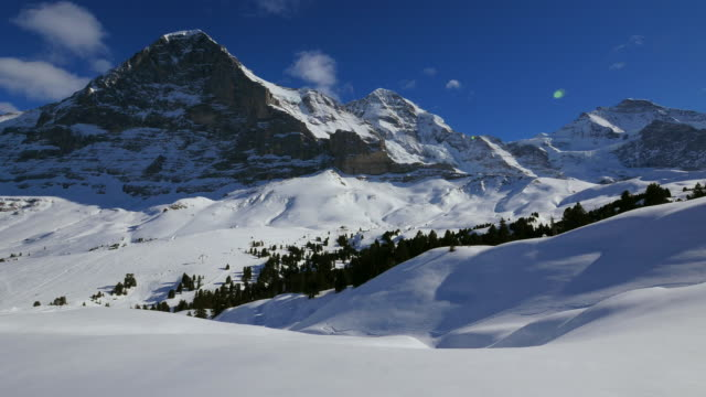 eiger, monch and jungfrau, bernese alps, switzerland, europe - bernese alps stock videos & royalty-free footage
