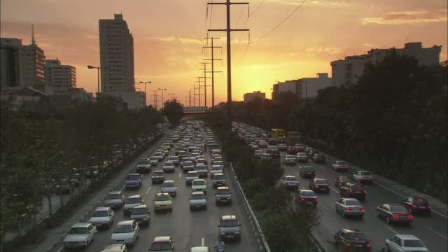 ws ha eight lanes of heavy, rush hour traffic at sunset / teheran, iran - teheran video stock e b–roll