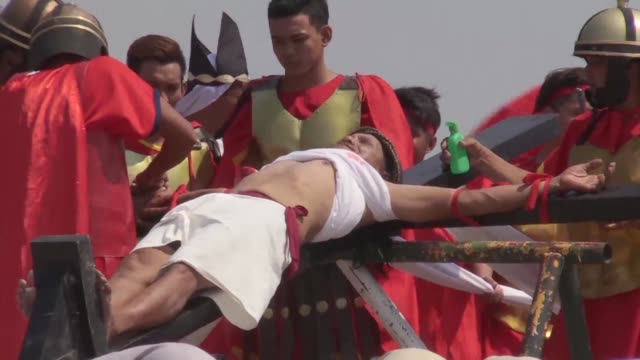 eight men and a woman were nailed to crosses while hundreds of barefoot men flailed themselves on good friday in a blood soaked display of religious... - holy week stock videos & royalty-free footage