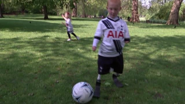 eight year old becomes tottenham mascot various shots marshall kicking ball in park close shot prosthetic legs - eight ball stock videos & royalty-free footage