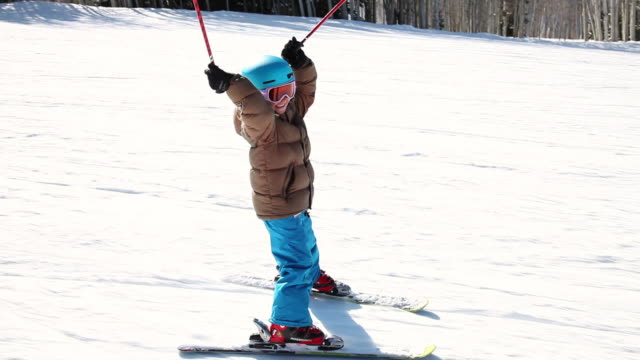 ms pov ts eight year old girl skiing fast down ski run / park city, utah, united states - avventura video stock e b–roll