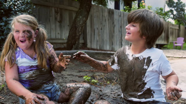 mud fight boy and girl