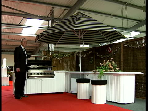 Eighteen foot long barbecue goes on sale at Harrods ITN London EXT i/c as along from shed to pull barbeque Rusted parts of barbeque Jon Pocock...