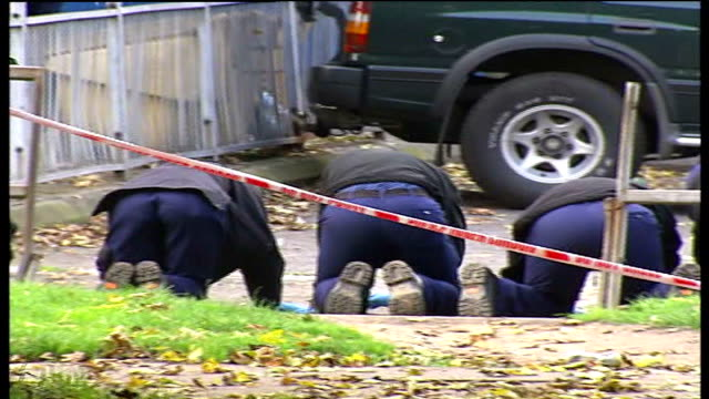 eighteen year old boy shot dead in woolwich england london woolwich ext police officers in cordoned off area near flats members of police on hands... - ウールウィッチ点の映像素材/bロール