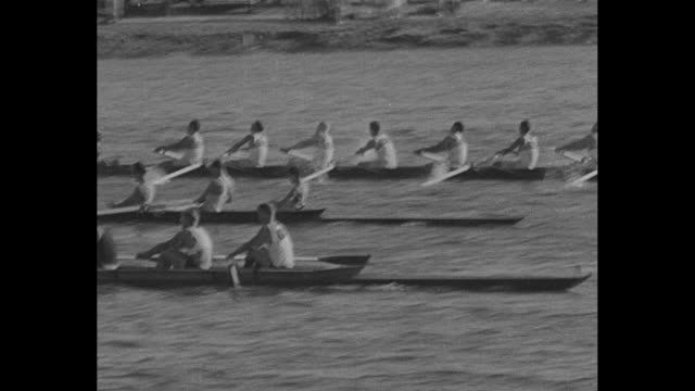 Eightman shells battle it out as nearest boat pulls away during rowing competition at Long Beach Marine Stadium during Summer Olympics / teams on...