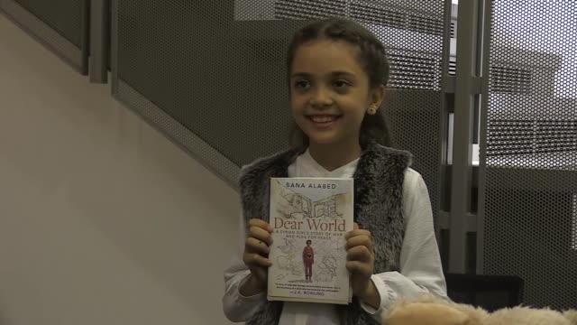 eightyearold syrian activist bana alabed whose tweets from wartorn aleppo captured a worldwide attention promotes her book dear world a syrian girl's... - book signing stock videos & royalty-free footage