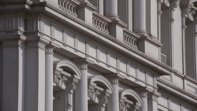 tu eisenhower executive office building with many windows surrounded by ornate pediments and columns / washington, district of columbia, united states - ペディメント点の映像素材/bロール