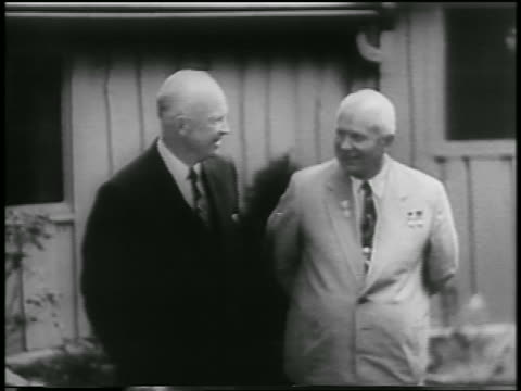 eisenhower khrushchev standing smiling in front of house / camp david / maryland - 1959 stock-videos und b-roll-filmmaterial