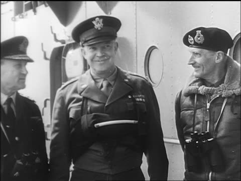 vidéos et rushes de eisenhower standing next to montgomery + smiling on ship deck / newsreel - 1944