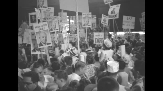 vs eisenhower supporters cheering many wear hats and hold up signs and posters including one shaped like orange reading florida for ike / candidate... - partito repubblicano degli usa video stock e b–roll