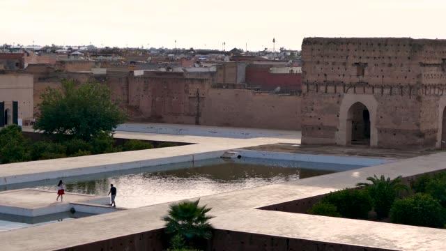 vidéos et rushes de el badi palace historic taking selfies tourist attraction taking photos marrakesh morocco - château