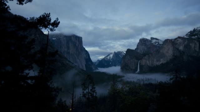 WS T/L El Capitan, Bridal Veil Falls and Half Dome covering by partial cloud / California, United States
