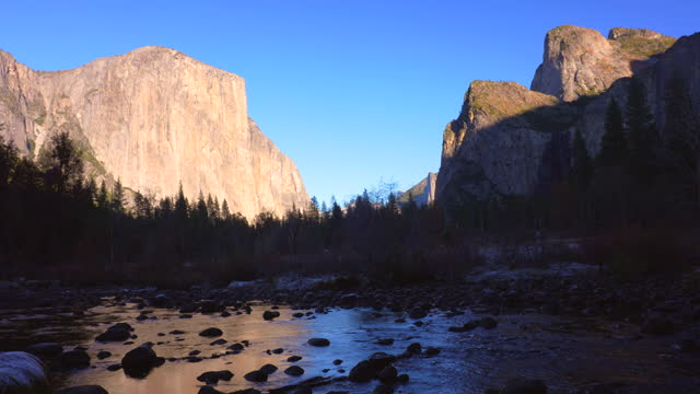 el capitan reflection into merced river with cathedral rocks and bridalveil fall, valley view, yosemite valley, yosemite national park, california, 4k video - river merced stock videos & royalty-free footage