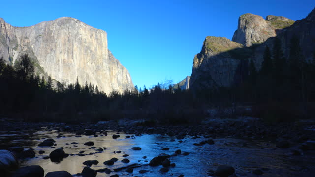 el capitan reflection into merced river with cathedral rocks, clear winter afternoon, yosemite valley, yosemite national park, california, 4k video - river merced stock videos & royalty-free footage