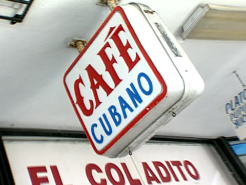 el coladito comida centro americana restaurant in little havana sign w/ telephone number zi cu cafe cubano sign attached to overhang zo/zi - comida stock videos & royalty-free footage
