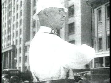 el dia de la aviacion es la fiesta mas amada por el pueblo sovietico', stalinist architecture, moscow streets with new buildings, traffic policeman... - 1937 bildbanksvideor och videomaterial från bakom kulisserna