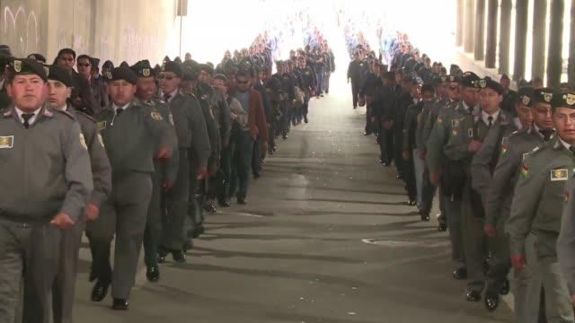 el gobierno boliviano califico de accion politica un movimiento de protesta de militares de bajo rango por reformas en la estructura de las fuerzas... - politica stock videos & royalty-free footage