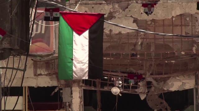 vídeos y material grabado en eventos de stock de el gobierno sirio plantea llevar a cabo una operacion militar en el campamento palestino de yarmuk en damasco tomado en gran parte por yihadistas del... - llevar