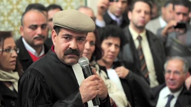 el lider de la oposicion en tunez chokri belaid fue asesinado a balazos el miercoles en lo que el primer ministro tunecino califico de acto de... - terrorismo stock videos & royalty-free footage