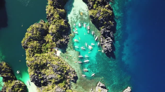 el nido palawan small lagoon miniloc island philippines aerial 4k video - bay of water stock videos & royalty-free footage