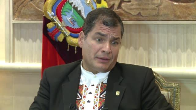 el presidente ecuatoriano rafael correa abogo el jueves en una entrevista con la afp por la creacion de una moneda regional y relato que estudia la... - entrada stock videos and b-roll footage