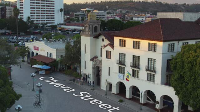"""el pueblo de los angeles with floating text: """"olvera street"""" - drone shot - history stock videos & royalty-free footage"""