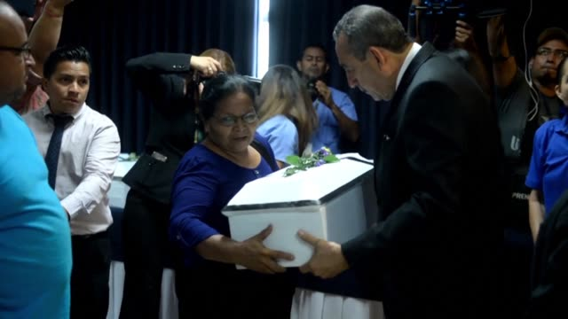 el salvadors supreme court of justice handed the remains of 11 victims of the 1981 massacre of el mozote when members of the us trained salvadorean... - mass murder stock videos & royalty-free footage