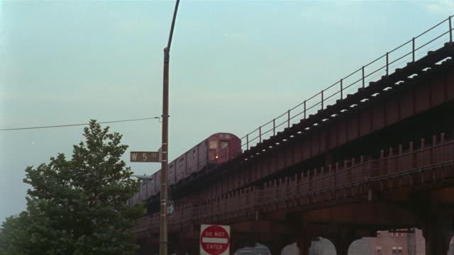 1969 ms pan el train moving past/ brooklyn, new york, usa - brooklyn new york stock videos & royalty-free footage