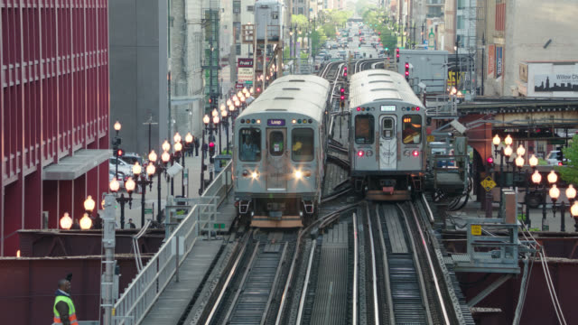 2 - el trains pass each other, chicago, il - chicago 'l' stock videos & royalty-free footage