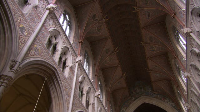 elaborate cathedral interior from ceiling, armagh, northern ireland - catholicism stock videos & royalty-free footage