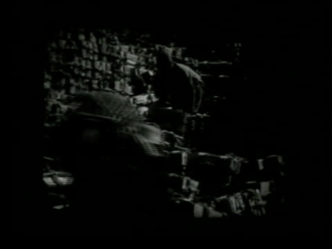 vidéos et rushes de elaborate design theatre. mixed audience seated in theater watching japanese propaganda newsreel: vs japanese w/ items from conquered areas stacking... - agression