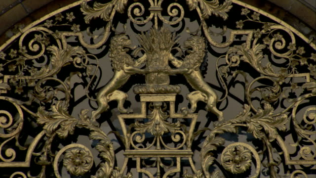 elaborate metalwork depicts two lions around a bundle of wheat, burghley house, northamptonshire. available in hd. - metalwork stock videos and b-roll footage