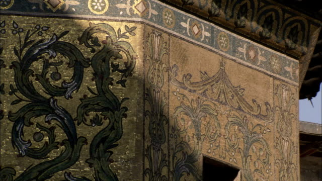 Elaborate mosaics of acanthus leaves decorate the exterior of the Umayyad Mosque Damascus. Available in HD.