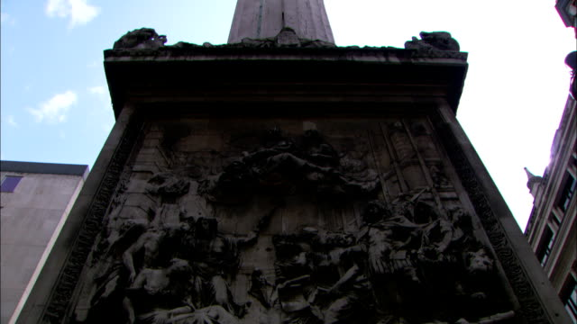 elaborate sculptures are seen on the pedestal of a london monument. - carving craft product stock videos & royalty-free footage