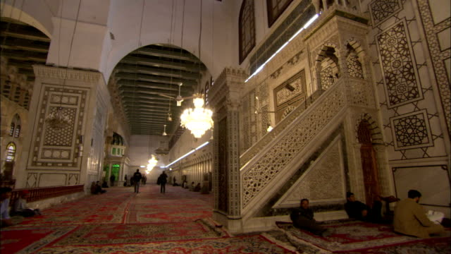 Elaborately decorated stairs are one of the many intricate designs in the Umayyad Mosque. Available in HD.