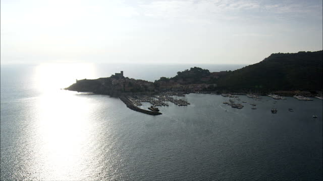 elba coastline in late afternoon light  - aerial view - tuscany, italy - island of elba stock videos & royalty-free footage