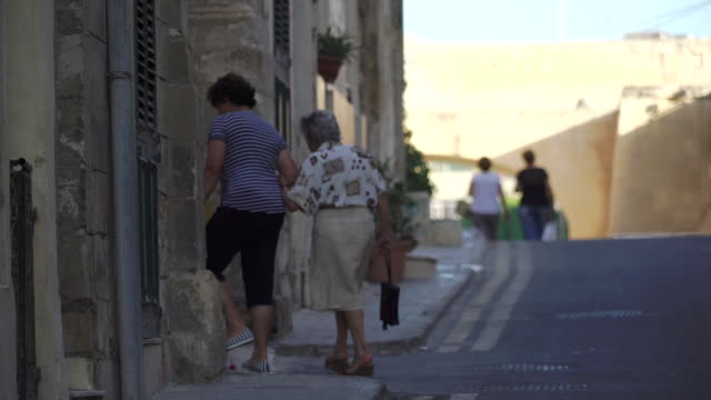 eldelry women leave mass at Catholic church - Malta