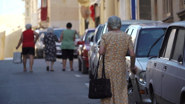 eldelry women leave mass at catholic church - malta - christianity stock videos and b-roll footage